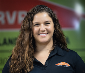 Woman with brown curly hair in a SERVPRO polo.