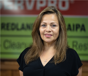 A lady in front of a green SERVPRO background